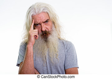 Close up of senior bearded man thinking with finger on head