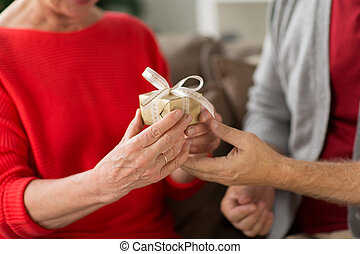close up of senior couple with christmas gift - christmas,...