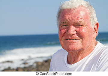 close-up of senior man on beach
