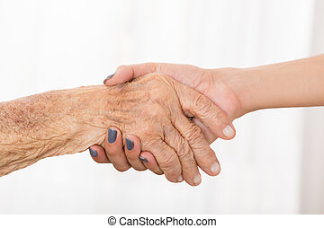 Senior Patient Shaking Hand With Female Doctor