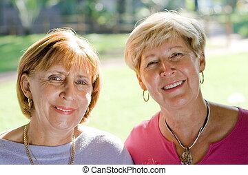 close up of senior sisters
