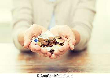 close up of senior woman hands holding money - savings,...