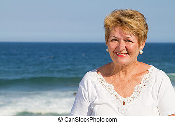 close-up of senior woman smiling at beach
