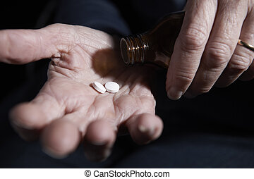 Close Up Of Senior Woman With Medication