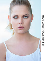 Serious Young Woman with Hair Pulled Back