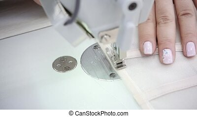 close-up of sewing machine, stitch thread seam. Equipment...