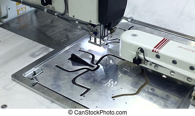 Close-up of sewing machine stitching on templates