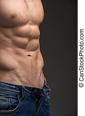 Close up of Sexy muscular nude male torso. Wearing unbutton...