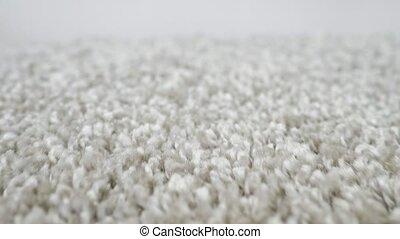 close-up of shaggy silver carpet camera movement.