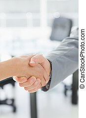 Close-up of shaking hands after business meeting