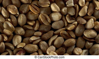 Close up of shelled peanuts rotating. - Close up of the...