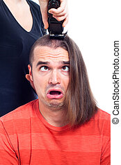 Close up of shocked long haired man being shaved
