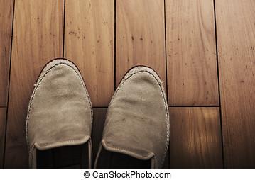 Close-up of shoes on wooden background