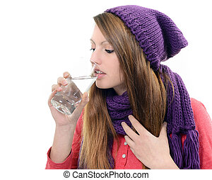 Close-up of sick pretty girl drinking water from glass