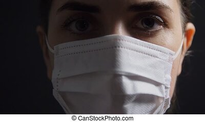 close up of sick woman in protective medical mask - health, ...