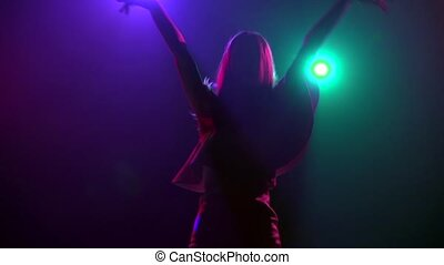Close-up of silhouette girl in rhythmic dancing. Slow motion