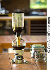 close up of siphon vacuum, coffee cup and siphon vacuum coffee maker at shop