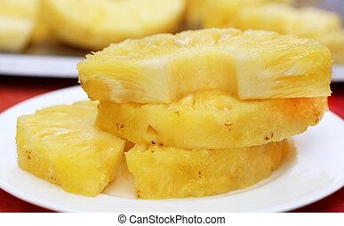 Sliced Pineapple - Close up of Sliced Pineapple on plate