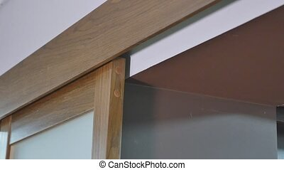 Close up of slide wooden door