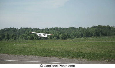 Close up of small airplane taking off
