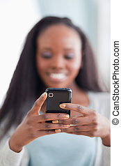 Close up of smartphone being held by woman