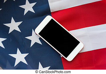 close up of smartphone on american flag