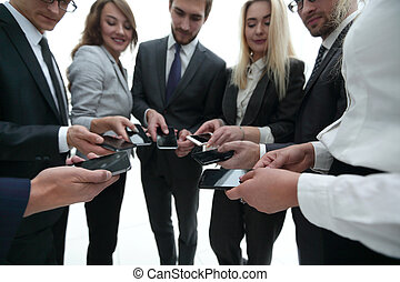 close-up of smartphones in the hands of business youth