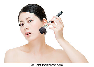 Close up of Smile woman with makeup brushes near face