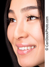 Close-up of smiling Asian woman in studio