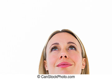 Close up of smiling blonde woman looking up