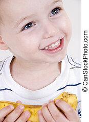 smiling boy with banana