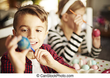 Close up of smiling boy with painted egg