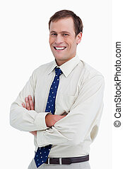 Close up of smiling businessman with arms folded