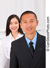 Close-up of smiling businesspeople