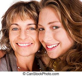Close-up of smiling elder mum and daughter