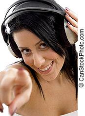 close up of smiling female holding headphone