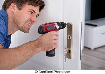 Happy Young Male Installing Door Lock