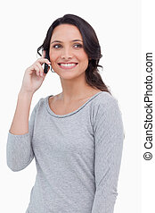 Close up of smiling woman on her mobile phone