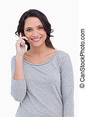 Close up of smiling woman on her cellphone