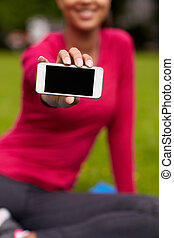 close up of smiling woman with smartphone