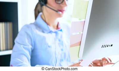 Close-up of smiling woman working in a call center