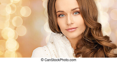 close up of smiling young woman in winter clothes -...