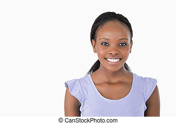 Close up of smiling young woman on white background