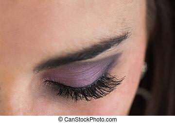 Close up of made up smoky eyes
