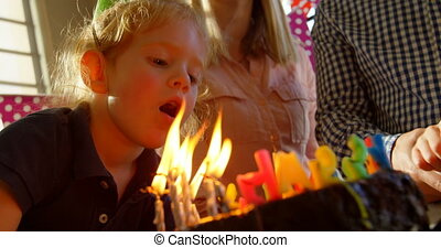 Close-up of son blowing out birthday candles 4k