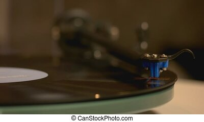 Close up of spinning vinyl record. Close up of stylus on a ...