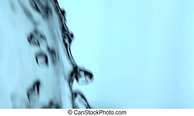 Close up of splash of water. Slow motion. - Close up of...