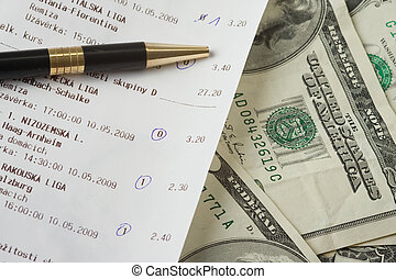 close up of sports betting slip and pencil