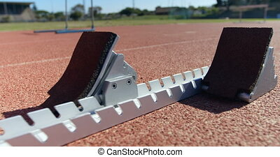 Close-up of starting blocks on a running track 4k - Close-up...