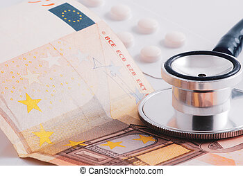 Close-Up Of Stethoscope On Paper Currencies. Protection Medical Insurance.
